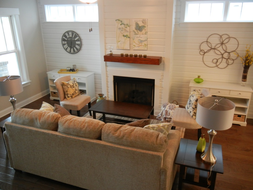 Model Home Living Room  This great room had a unique shiplap wall feature   To keep the space warm and cozy I used upholstered furniture for the  seating and. Portfolio   Blue Diamond Staging